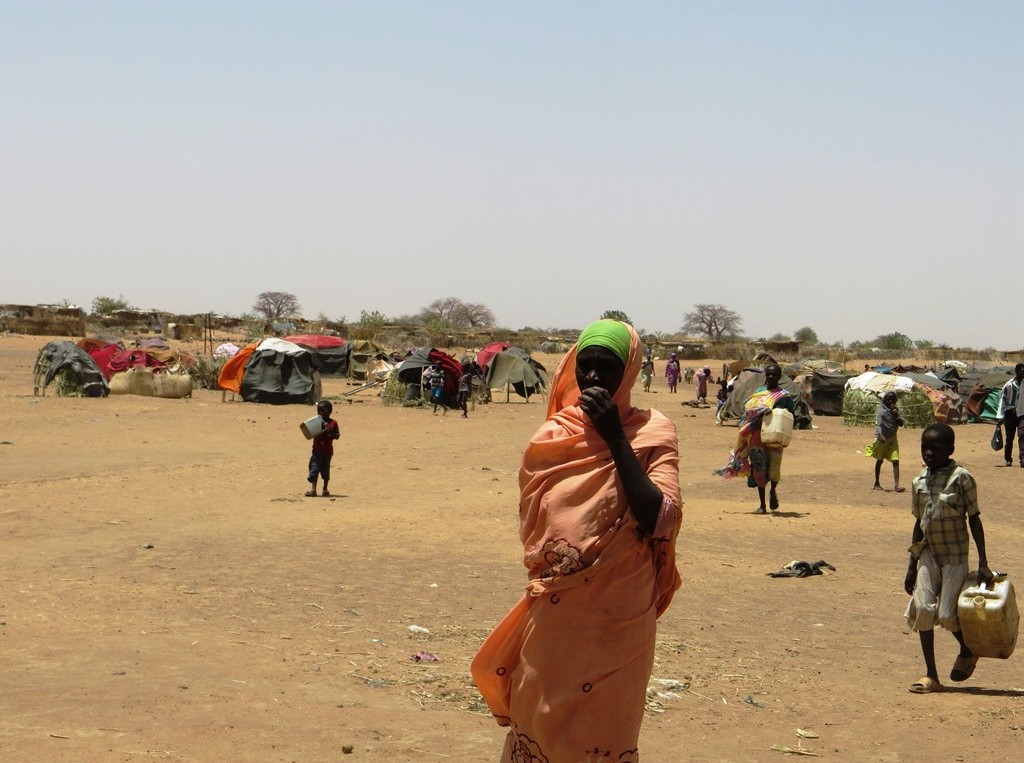 People newly uprooted from their homes in Darfur now live in makeshift shelters. Many have made long and dangerous journeys to reach camps like this where they can find, if not comfort, at least a measure of safety. Photo: Sahar Ali/Oxfam America