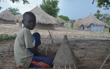 A South Sudanese boy living in the Odobu refugee settlement in Uganda plays with a toy hut he constructed. Photo: Dorah Ntunga/Oxfam