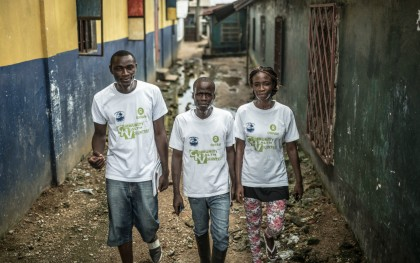Community health volunteers in Clara Town, a township north of Monrovia, Liberia, are  going door to door to help fight Ebola.  Photo: Pablo Tosco/Oxfam