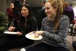 "Students in the ""low income"" group share a simple meal of rice at an Oxfam America Hunger Banquet at Northeastern University on November 16, 2014. This fall, volunteers around the country are organizing interactive Oxfam America Hunger Banquets as a way to educate others about the inequalities of hunger. Photo: Coco McCabe/Oxfam America"