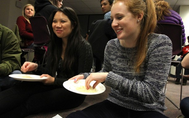 """Students in the """"low income"""" group share a simple meal of rice at an Oxfam America Hunger Banquet at Northeastern University on November 16, 2014. This fall, volunteers around the country are organizing interactive Oxfam America Hunger Banquets as a way to educate others about the inequalities of hunger. Photo: Coco McCabe/Oxfam America"""