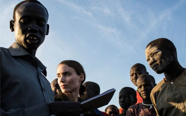 Actress and Oxfam ambassador Rooney Mara with a group of young South Sudanese men who have been displaced by fighting during the last year. Photo: Mackenzie Knowles-Coursin/Oxfam America