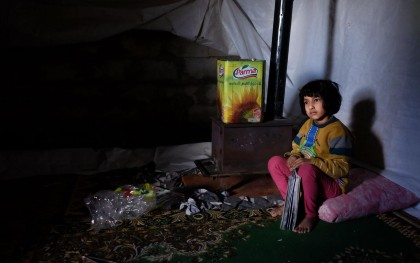 Six-year-old Raneem in her family's shelter in northern Lebanon.  During the storm, the water leaked through the walls and the window in the tent where she lives with her parents and brothers. They had to move to another tent. Photo: Oriol Andres/Oxfam