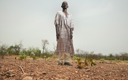 """Last fall I got almost no harvest. There was not enough rain,"" farmer Kassa Danfakha of Kedougou, Senegal,  told Oxfam in 2012. ""The first rains came and the seeds we planted started to grow, but then the rain was very irregular."" Millions of farmers like Danfakha faced a food crisis that year in part because of this shortage of rainfall. Photo: Brett Eloff/Oxfam America"