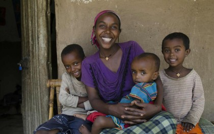 Bertukan Girma of Kentery, Ethiopia, and her three children. After Oxfam provided Girma with a backyard irrigation pump and agricultural training, she and her husband built a thriving small business that now sustains their family. Photo: Eva-Lotta Jansson/Oxfam America