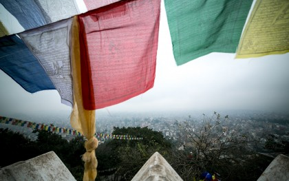 Prayer flags outside the city of Kathmandu in 2014, prior to the recent earthquake. Photo: Dewald Brand, Miran for Oxfam