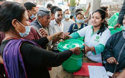 Oxfam distributes hygiene kits in Sankhu. The kits contain a bucket for clean water, a bar of soap, oral rehydration salts, and towels, helping people to meet their basic sanitation needs.   Photo: Aubrey Wade / Oxfam