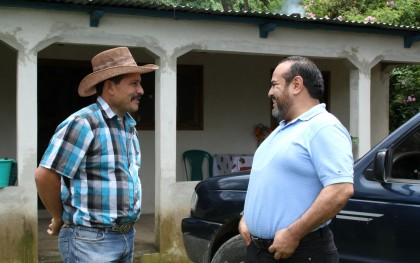 Rafael Maldonado (right) meets with farmer Guillermo Carrera at Carrera's home near San Rafael Las Flores, Guatemala. Carrera was one of the people unjustly accused of numerous crimes, and spent months in jail before being released for lack of evidence. Photo: Chris Hufstader/Oxfam America