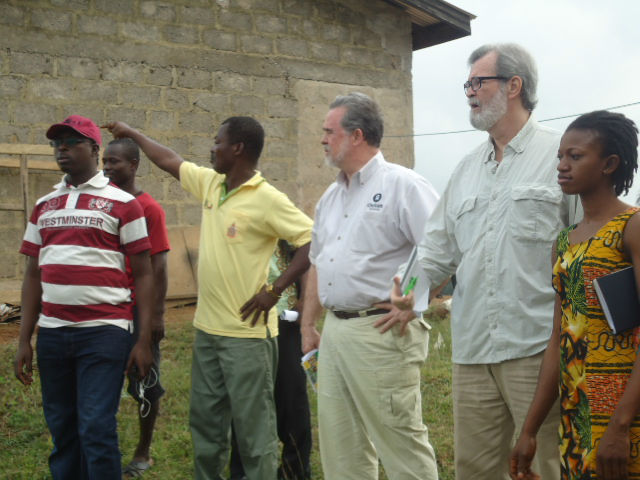 Oxfam Active Citizenship Advisor Abdulkarim Mohammed, (left, in red and white shirt), Oxfam President Ray Offenheiser (middle) and Oxfam Board Chair Joe Loughrey (with glasses) traveled in January to Ghana, where small-scale farmers, women's organizations, and local citizen organizations are celebrating the government's commitment to investing oil revenues in agriculture. Here they talk with community members at the Anglogold processing plant in Teberebie, Ghana. Photo: Enoch K. Norvor / Oxfam