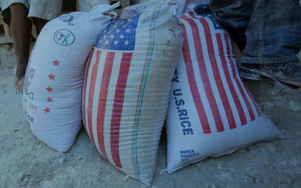 The US provides emergency food aid like these sacks of rice and other humanitarian relief where it is needed, but local and regional procurement helps build the capacity of people and their governments to meet their own needs. Photo: Toby Adamson / Oxfam