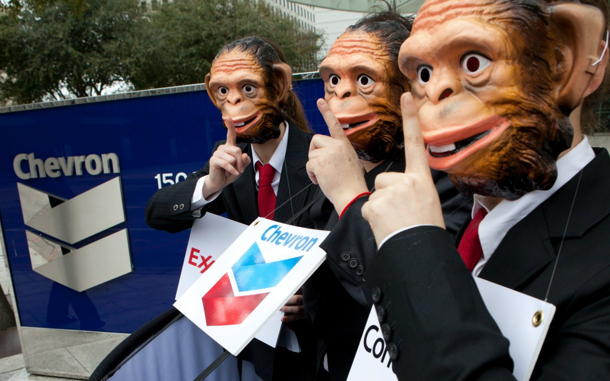 "Activists outside the offices of Chevron in Houston, Texas call for oil companies to accept strong rules to implement the transparency provisions in the 2010 Dodd-Frank Wall Street Reform Bill. Portraying oil companies as monkeys in the ""see no evil, speak no evil"" proverb was a way to expose efforts by the oil industry to encourage the Securities and Exchange Commission to enact weak rules that will allow them to continue to make secret payments to governments. Photo: Scott Dalton / Oxfam America"