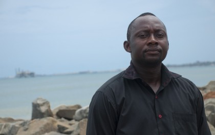 Kyei Kwadwo Yamoah is the Natural Resources Program Coordinator for Friends of the Nation (FON) in Ghana, which has been supporting local coastal communities to monitor environmental impacts of the oil industry, and advocate on behalf of fishing communities and others in the coastal areas. Friends of the Nation are one of 100 members of the Civil Society Oil Platform, an association that is advocating for transparent management of oil revenue. Here Yamoa is pictured off the coast of Sekondi and Takorade, in the Western Region of Ghana. Photo: Jeff Duetsch / Oxfam America