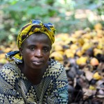 Felicia Adebowale, a  cocoa farmer, sits next to harvested cocoa beans inside her farm in Ayetoro-Ijesa village, Nigeria. Photo: George Osodi / Panos for Oxfam America.