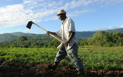 Oblin Tuse, 56, prepares the soil for planting in Belladere, Haiti in May 2010. The region has problems with very severe erosion and with landslides. Photo: Ami Vitale/Oxfam America