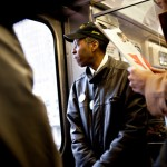 Tyree Johnson, who's worked for 20 years at a  fast-food restaurant, rides a train on his way  to work in Chicago. The pay gap separating  fast-food workers from their chief executive  officers is growing dramatically. Photo: Judy Griesedieck / MCT /MCT via Getty Images
