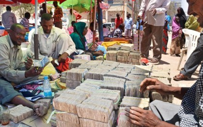 Bundles of Somaliland's currency are laid out by a money-changer on a street in Hargeisa, capital of the unrecognized breakaway republic of Somaliland in northwestern Somalia. Photo: Kyodo/Landov via NPR http://bit.ly/1vfZHCt