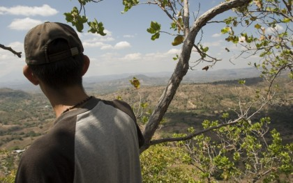 Residents of San Isidro (Cabañas, El Salvador) look out over a valley where Pacific Rim/OceanaGold hopes to begin mining gold and silver. Photo: Jeff Deutsch / Oxfam America