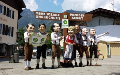 G7 leaders try to find directions to ending poverty at the summit in Bavaria: Oxfam Germany stunt. Photo: Gawain Kripke/Oxfam America.